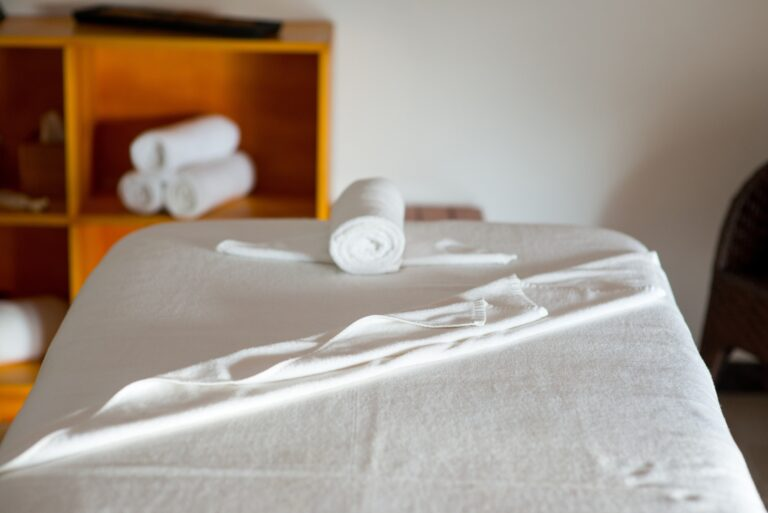rolled towel on massage table in spa center