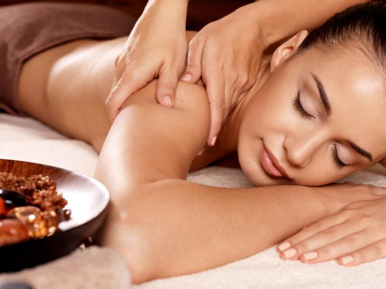 Woman having swedish massage in the spa salon